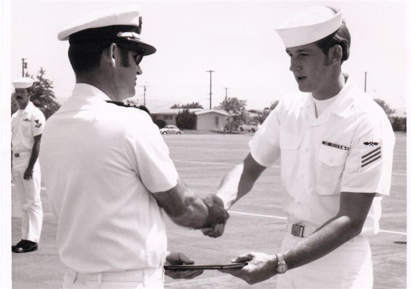 Jerry Denman receiving a commendation at the Naval Air Station in Miramar, California. Check out the sideburns.