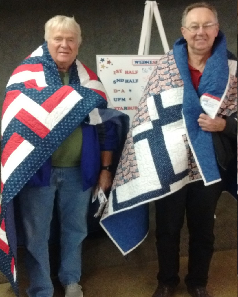 Members Ron Jensen & Don Reconnu display their quilts.