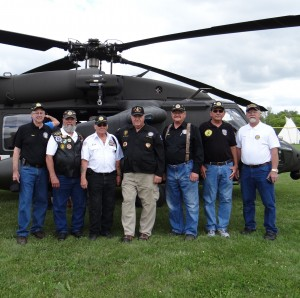 Standing in front of the Blackhawk Helicopter are Don Reconnu, Dean Halajian, Jack Kempter, Phil Braeger, Don Borgen, Larry Longstreet & Dennis Solberg