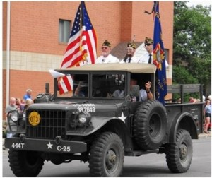 Phil Braeger hauling the VFW in his pickup. Jim Hanson is riding with the VFW.