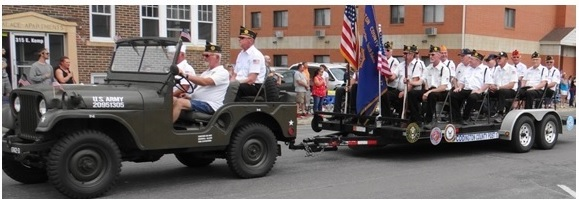 Dana Jones with his jeep pulling the Americas Legion. Riding with Dana was Dennis Brenden and in the trailer was Byron Callies.